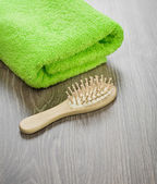 Hairbrush with towel — Stok fotoğraf