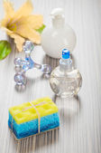 Massager sponge soap flower and bottles — Stock Photo