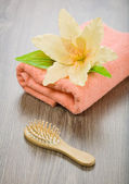Flower on pink towel with hairbrush — Stok fotoğraf
