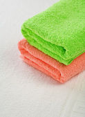 Pink and green towels on white background — Stock Photo