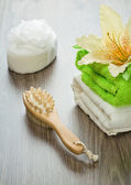 Flower on towels bath sponge massager and brush — Stock Photo