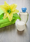 Bottle towel flower and cotton pads — Stock Photo