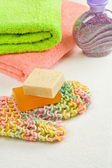 Soap on bast and towels with salt — Stok fotoğraf