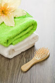 Flower on cotton towels with hairbrush — Stock Photo