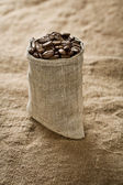 Coffee grains in bag — Stock Photo