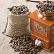 Coffee beans in bag and coffee mill — Stock Photo