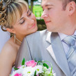 The groom and the bride look against each other - Stock Photo