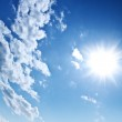 Blue cloudy sky and sun — Stock Photo #5075865