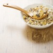 Bowl with muesli on wooden background — Stock Photo #5076058