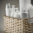 Bottles and paper towel in basket - ストック写真