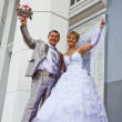 Bride and the groom on a background of a building — Stok fotoğraf