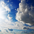 Cloudy heaven and sun - Stock Photo
