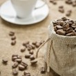 Coffee beans and cup of coffee — Stock Photo