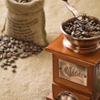 Coffee beans in bag and coffee grinder — Photo