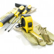 Gloves with tools for building — Stock Photo #5078629