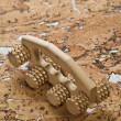 Stock Photo: Massager on cork wood