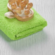 Stock Photo: Massager on green towel