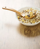 Bowl with muesli on wooden background — Stock Photo