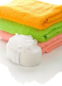Bath sponge with towels — Stock Photo