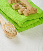 Brush and massager with cotton towel — Stock Photo