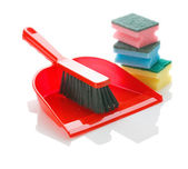 Brush on dustpan with sponges — Stock Photo