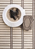 Coffee composition of cappuchino on mat — Stock Photo