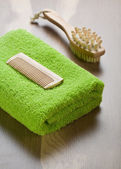 Comb and massager with towel — Stock Photo