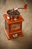 Coffee mill on sacking — Stock Photo