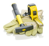 Gloves with hammer and measuring tape — Stock Photo
