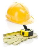 Casco con cinta métrica y guante — Foto de Stock