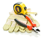 Gloves with tapeline and pliers — Stock Photo