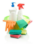 Green basin with cleaning objects — Stock Photo