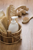 Hairbrush massager and wooden bucket — Stok fotoğraf