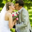Stock Photo: Wedding pair kisses