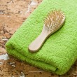 Towel and hairbrush on cork wood - Stok fotoğraf