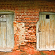 Two old doors and brick wall — Stock Photo