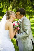 Wedding pair kisses — Stock Photo
