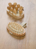 Wooden massagers on wooden background — Stock Photo