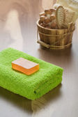 Soap on towel with wooden bucket — Stock Photo