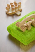 Wooden massagers and towel — Stock Photo