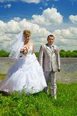 Wedding pair on coast of the river — Stock Photo