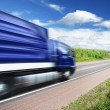 Truck speeding on country highway, motion blur — Stock Photo