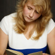 Stock Photo: Young girl reading book