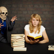 Stock Photo: Woman reads a scary books