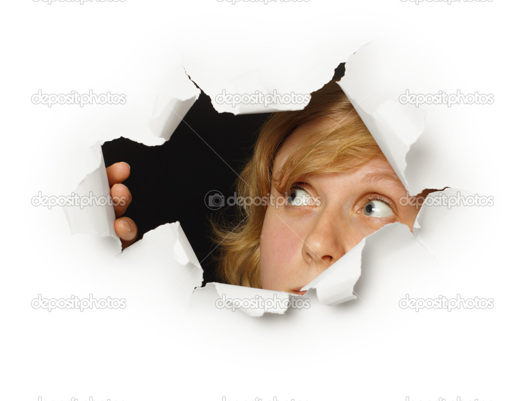 A woman looks out of the hole with curiosity  Stock Photo #3952941