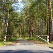 Barrier blocking road in woods — Stock Photo #4002664
