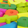 Stock Photo: Colored wooden letters and numbers