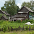 Old dilapidated rustic wooden houses - Foto Stock