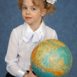 Schoolgirl with geographic globe — Stock Photo #4026289