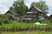 Old dilapidated rustic wooden houses — Stock Photo